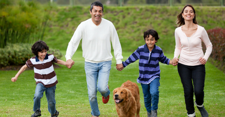 family in the park with dog
