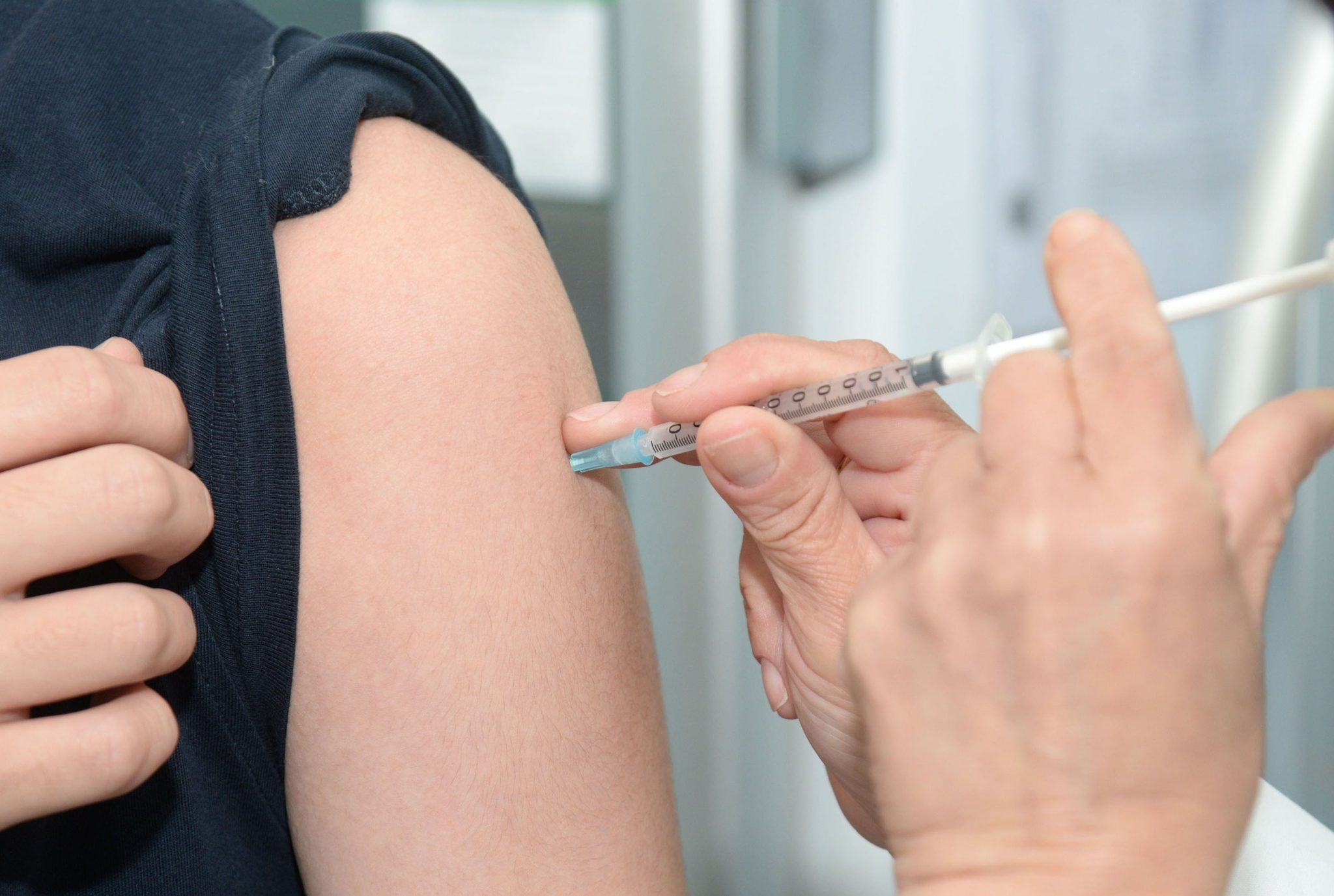 getting a vaccination in the arm
